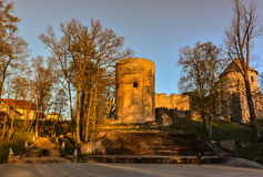 Beautiful afternoon light in park with old castle ruins. Beautiful afternoon light in public park with green grass and old castle ruins. Shot in Cesis, Latvia Stock Image