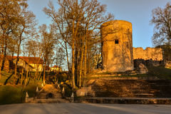 Beautiful afternoon light in park with old castle ruins. Beautiful afternoon light in public park with green grass and old castle ruins. Shot in Cesis, Latvia Stock Photos