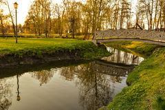Beautiful afternoon light in public park. With green grass and bridge. Shot in Cesis, Latvia Royalty Free Stock Image
