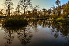 Beautiful afternoon light in public park. With green grass and pond. Shot in Cesis, Latvia Royalty Free Stock Image