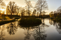 Beautiful afternoon light in public park. With green grass and pond. Shot in Cesis, Latvia Stock Photography