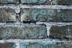 Beautiful aged and weathered blue brick wall surfaces in a close up view royalty free stock photo