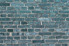 Beautiful aged and weathered blue brick wall surfaces in a close up view stock image