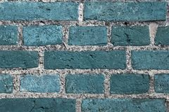 Beautiful aged and weathered blue brick wall surfaces in a close up view stock photography