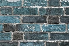 Beautiful aged and weathered blue brick wall surfaces in a close up view royalty free stock photography