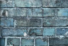 Beautiful aged and weathered blue brick wall surfaces in a close up view royalty free stock image