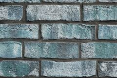 Beautiful aged and weathered blue brick wall surfaces in a close up view stock photo