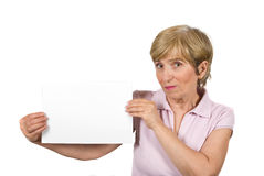 Beautiful aged woman with blank page. Beautiful older woman holding a blank page and looking surprised at you isolated on white background,check also People with Stock Photography