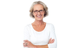 Beautiful aged woman with crossed arms Stock Photo
