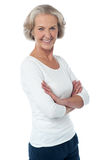 Beautiful aged woman with crossed arms. Aged woman with crossed arms isolated over white Royalty Free Stock Images