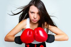 Beautiful aggressive female boxer Royalty Free Stock Photos