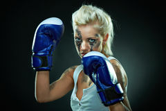 Beautiful agressive boxer girl Stock Image