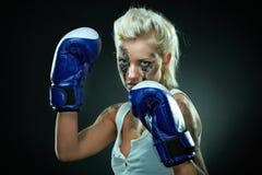 Beautiful agressive boxer girl Stock Image