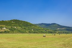 Beautiful agriculture landscape at the outback of Istria, Croatia. Beautiful agriculture landscape scenery with mountains, hills and farmland on a sunny summer royalty free stock photo