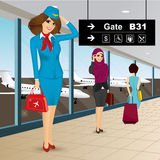 Beautiful air hostess in an airport Royalty Free Stock Image