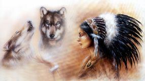 Young indian woman wearing a gorgeous feather headdress, with an image of two wolves  Royalty Free Stock Photo