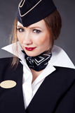 Beautiful airhostess Royalty Free Stock Photography
