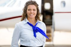 Beautiful Airhostess With Private Jet In Royalty Free Stock Image