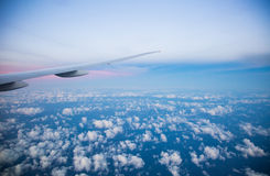 Beautiful airplane view above clouds Royalty Free Stock Photo
