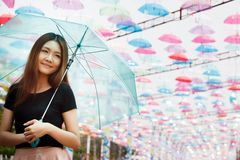 Beautiful Aisan girl with umbrellas Royalty Free Stock Photography