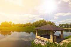 Beautiful alcove on a lake in spring sunny day with bright sunli Royalty Free Stock Photography