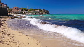 Beautiful Algaloja old town and sandy beach with turquoise clear water on Corsica, France stock footage