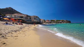 Beautiful Algaloja old town and sandy beach with turquoise clear water on Corsica, France. Beautiful Algaloja old town and sandy beach with turquoise clear water stock footage