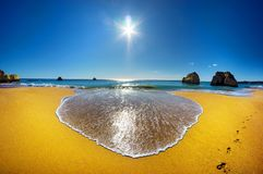 Beautiful Algarve beach Praia da Rocha in Portugal. On a sunny cloudless day, no people on the beach, spotless blue sky, yellow sand and bright rocks, a huge stock photography