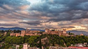 Beautiful Alhambra in sunset 1. Sunlit Alhambra during sunset with snowy peaks of sierra nevada in the background, seen from Mirador San Nicolás royalty free stock photo