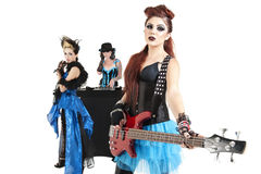 Beautiful all female rock band over white background Royalty Free Stock Images