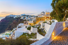 Beautiful alleys of the famous Fira town after sunset at twilight time. Santorini island. Stock Photography