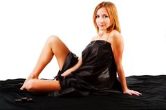 Beautiful alluring young girl on black bed Stock Photos