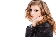 Beautiful alluring young girl in black jacket Stock Photo