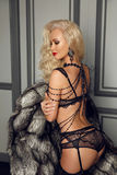 Beautiful alluring young woman in sexy black lingerie and luxury Stock Photos