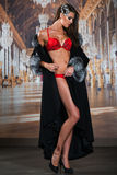 Beautiful alluring young woman in sexy red lingerie and luxury fur coat Royalty Free Stock Image