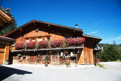 Beautiful Alm at the Alps, Austria. Image of a beautiful Alm blockhouse in Pertisau at the Achensee in the Austrian Alps. The typical architecture at the houses Stock Photo