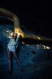 Beautiful alone girl and abandoned sewerage underground with ray of sunshine. Stock Images