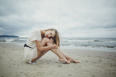 Beautiful alone girl on the beach Stock Images