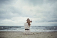 Beautiful alone girl on the beach stock photo
