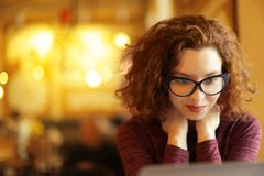 Beautiful girl in cafe. Beautiful alone girl in cafe Royalty Free Stock Images
