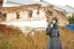 Beautiful alone woman  in grey coat outdoors Stock Image