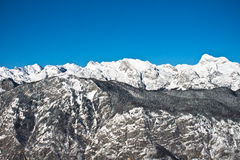 Beautiful alpine chain of snowy mountains of julian alps in blue sky Royalty Free Stock Photography