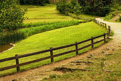 Beautiful alpine farm with road Stock Image