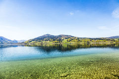 Beautiful alpine lake Attersee with crystal water Stock Photos