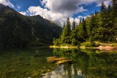 Beautiful alpine lake in the mountains, summer landscape, Morske Oko, Tatra Mountains, Poland. Beautiful alpine lake in the mountains, summer landscape with blue stock images