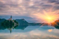 Beautiful alpine lake, nature landscape, Bled, Alps, Slovenia. Mystical morning landscape, alpine lake Bled, popular tourist destination in Alps, Slovenia royalty free stock photography