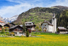 Beautiful Alpine landscape  with church  and typical Swiss houses  at spring sunny day , Inden village , canton of Valais , Switze Stock Photos