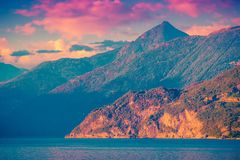Beautiful Alpine mountains and Como lake, Lombardy, Italy. Beautiful Alpine mountains and Como lake at sunset, Lombardy, Italy royalty free stock images
