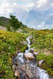 Beautiful alpine scenery with waterfall, waterfall in Alps. Mountain landscape royalty free stock image