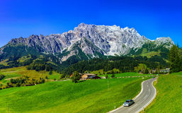 Beautiful alpine summer landscape. Mountains and sun, blue sky, Royalty Free Stock Images